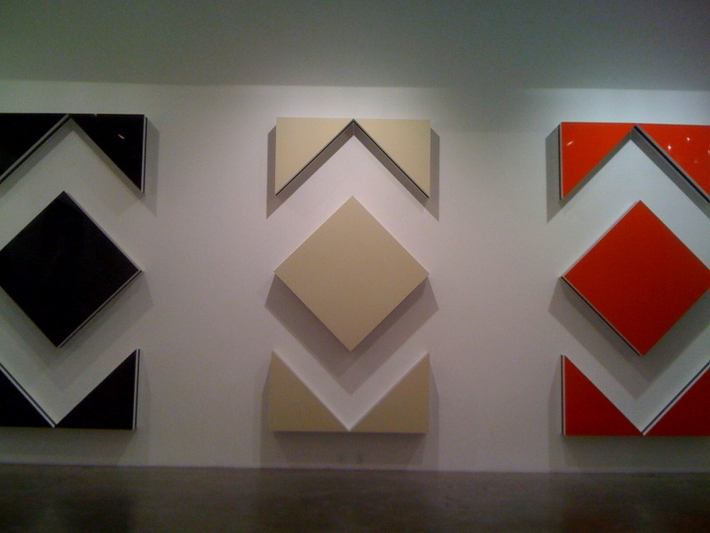 Cut-out situated work in five parts, jet black, light ivory, traffic red, 2009,