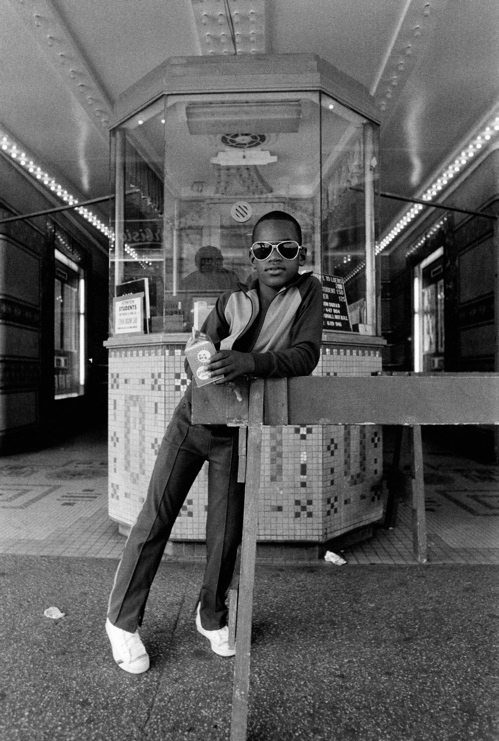 2 Dawoud Bey, A Boy in Front of the Loews 125th Street Movie Theater, 1976, Silver print, The Studio Museum in Harlem, gift of the artist