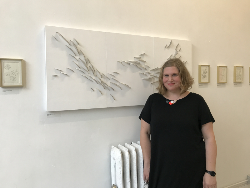 Natale Adgnot stands beside her work Dispersion Triptych, 2020