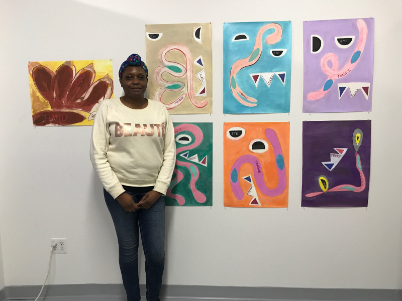 Yvena Despagne in her studio with her Monster series