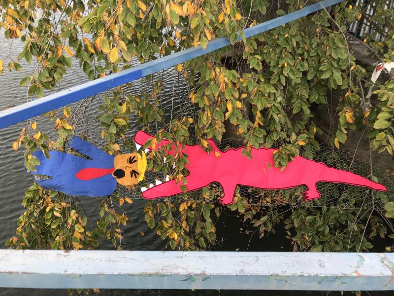 Ellie d'Eustachio's 8-foot pink alligator takes a chomp out of Trump by the Carroll Street Bridge  Gowanus