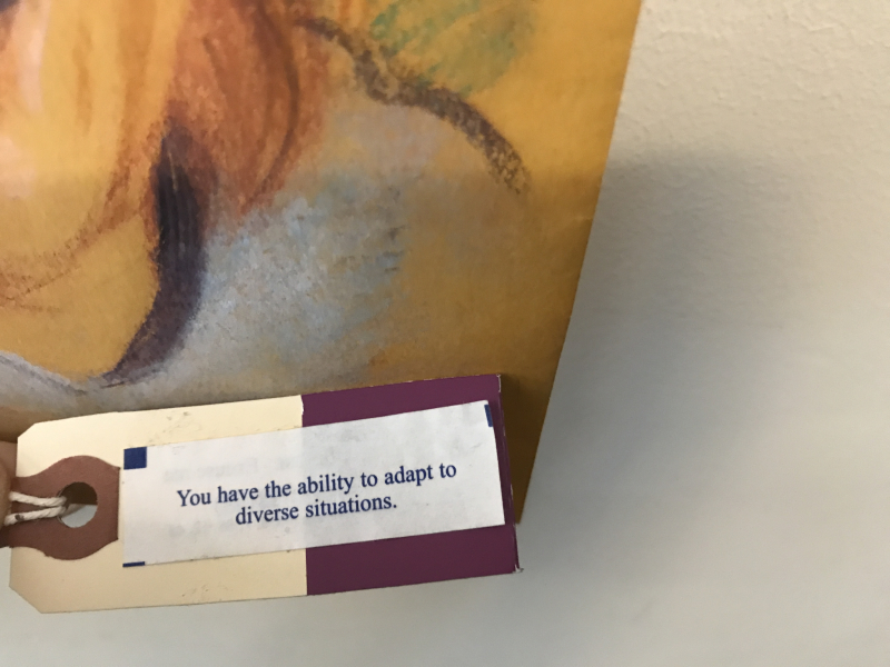 Fortune cookie wisdom attached to Roxanna Velandria's portrait of Elise Long
