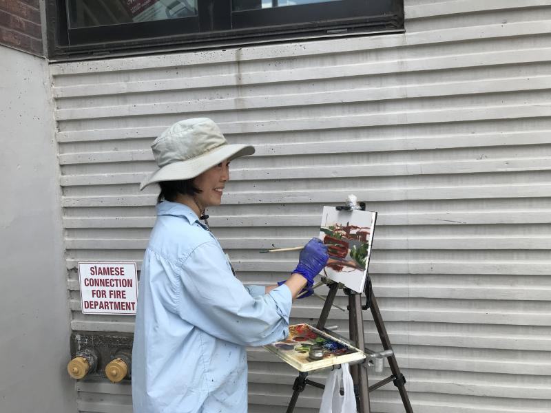 Ella Yang at work outside the Gowanus Dredgers Boathouse